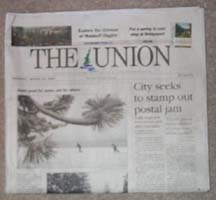 (photo of March 24 newspaper, above the fold)