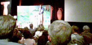 [blurry photo of Heinberg speaking]