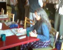 [photo of Barbara Coffman doing crossword puzzle at Java John's]